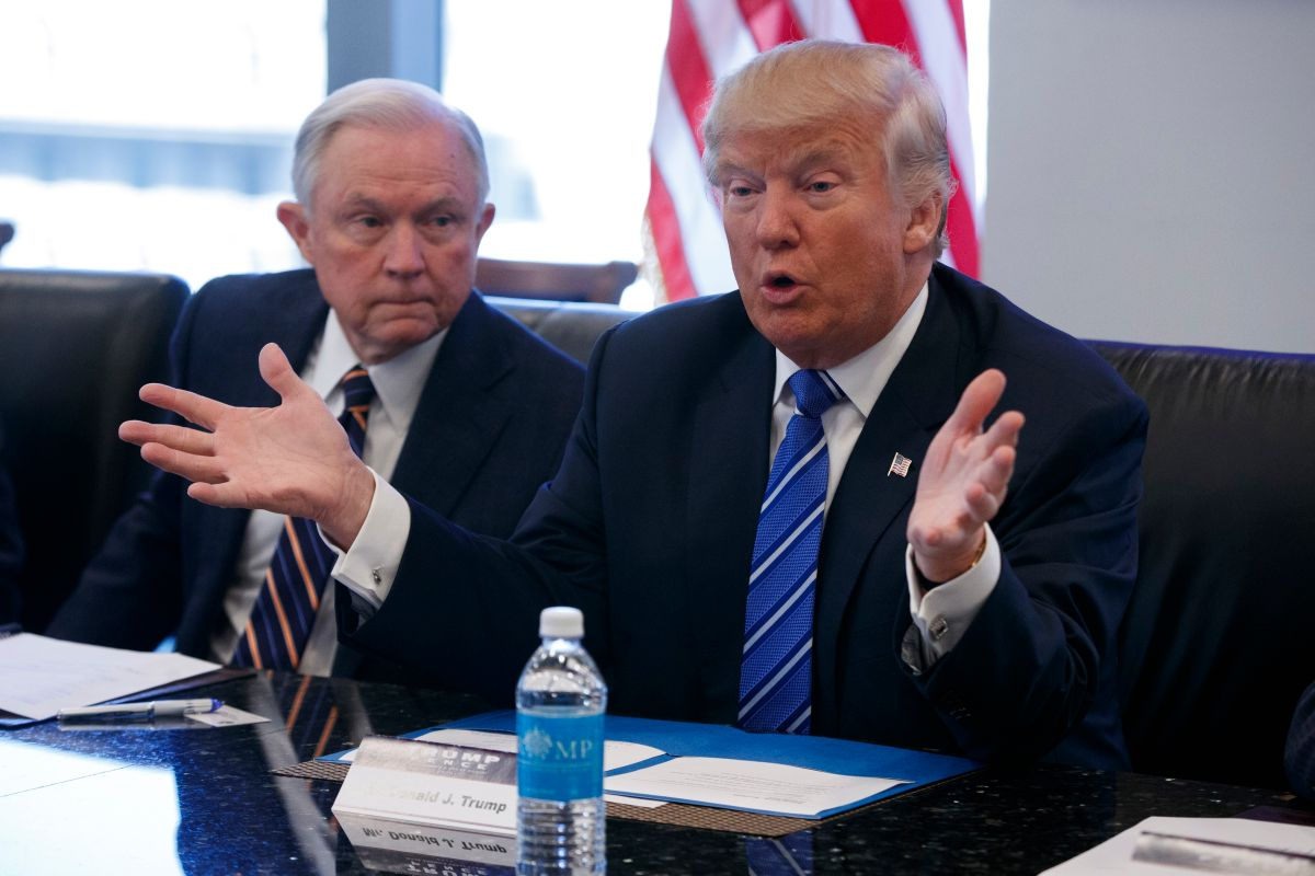 FILE - In this Oct. 7, 2016 file photo, Sen. Jeff Sessions, R-Ala. listens at left as then-Republican presidential candidate Donald Trump speaks during a national security meeting with advisers at Trump Tower in New York.  (AP)