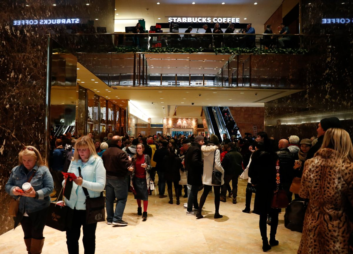 Tourists, pedestrians and security gather in the lobby of Trump Tower in New York, Monday, Nov. 21, 2016.  (AP)