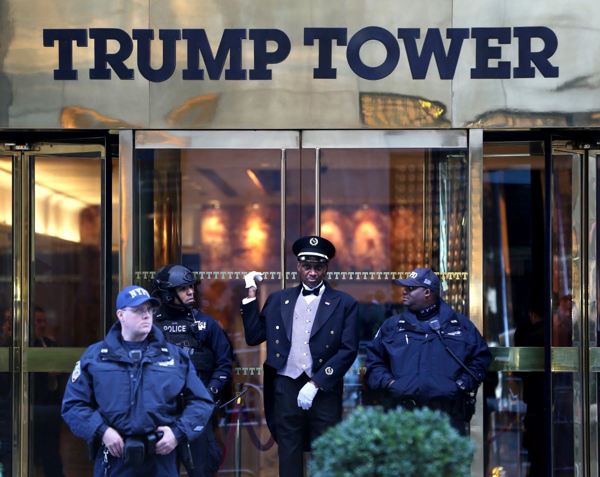 A doorman, center, talks with security personnel at the front entrance of Trump Tower in New York, Thursday, Nov. 17, 2016.  (AP)
