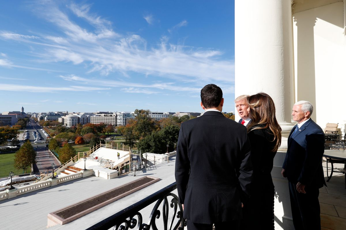 House Speaker Paul Ryan of Wis. shows President-elect Donald Trump, his wife Melania and Vice president-elect Mike Pence the view of the inaugural stand that is being built and Pennsylvania Avenue from the Speaker's Balcony on Capitol Hill in Washington. (AP)