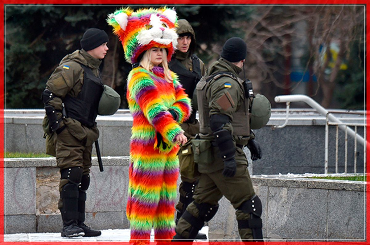 Ukrainian National Guard members walk past a woman wearing a colourful costume as they patrol near Independence Square in Kiev on November 22, 2016 following a night of violence by activists of some far-right Ukrainian parties. Kiev police said they were investigating an attack by far-right activists on a Russian bank and the office of a Ukrainian politician who is close friends with Kremlin chief Vladimir Putin. Ukraine had marked the third anniversary of the start of three months of protests that resulted in the country's Russian-backed former president being ousted in February 2014 as the former Soviet republic set on a pro-European Union course. / AFP / Sergei SUPINSKY        (Photo credit should read SERGEI SUPINSKY/AFP/Getty Images) (Afp/getty Images)