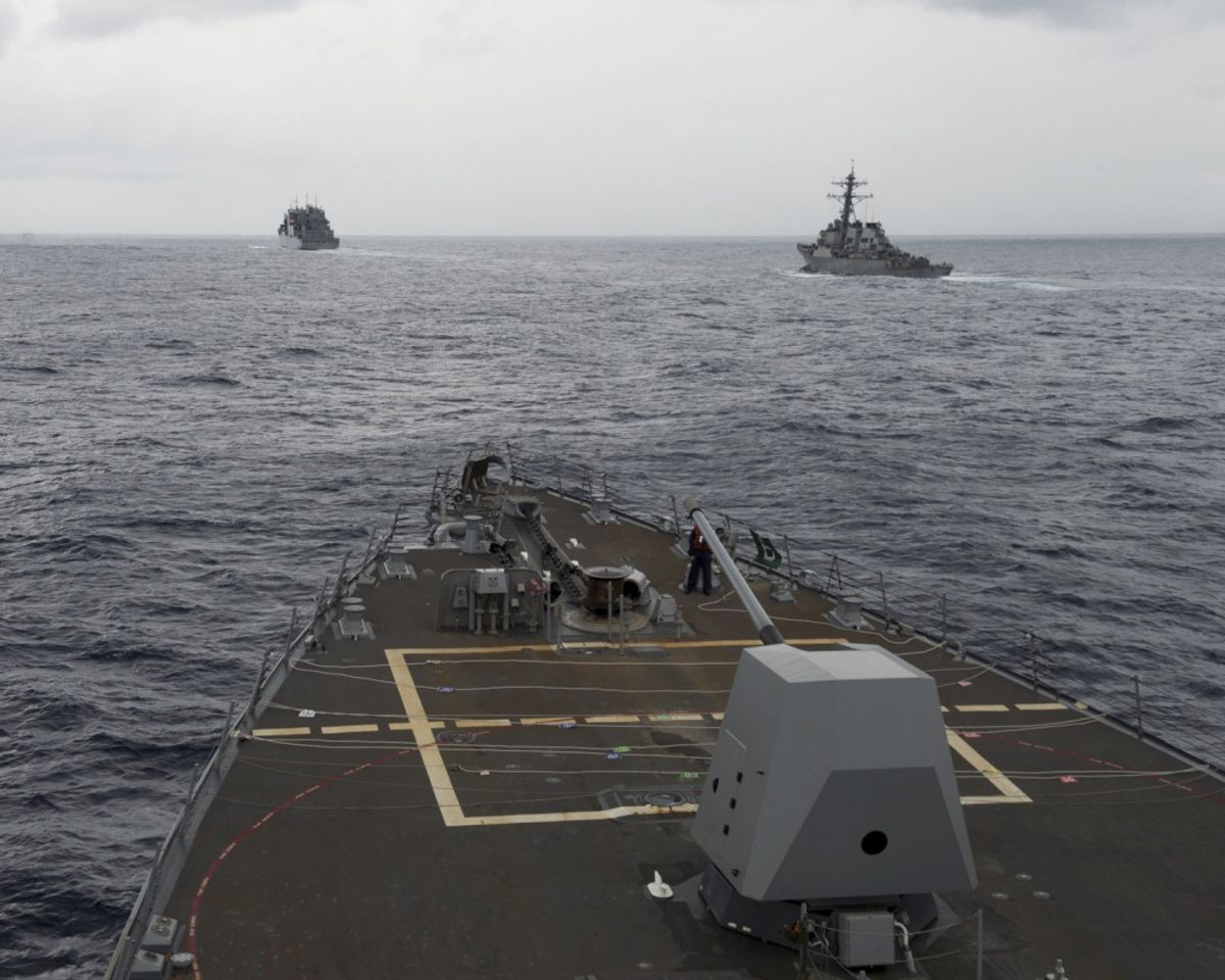 FILE - This Oct. 17, 2016 file image provided by the U.S. Navy,  shows the guided missile destroyer USS Decatur, right, pulling into position behind the Military Sealift Command USNS Matthew Perry, during a replenishment-at-sea, seen from the bridge of the guided-missile destroyer USS Spruance, in the South China Sea. The commander of U.S. forces in the Pacific Adm. Harry Harris said he's concerned with China's assertiveness in the South China Sea and the East China Sea as he headed to the Philippines to discuss the next round of joint exercises. (U.S. Navy/Petty Officer 2nd Class Will Gaskill via AP, File) (AP)