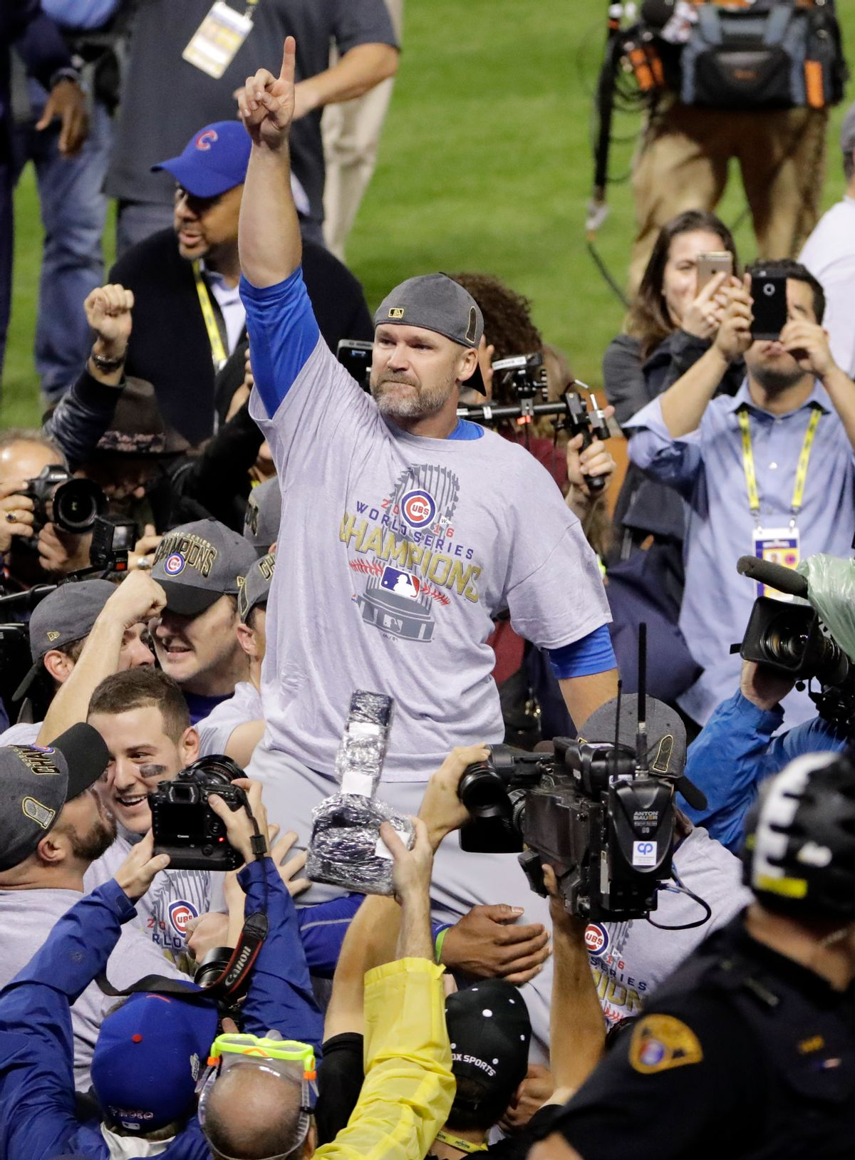 Chicago Cubs' David Ross is carried by teammates after Game 7 of the Major League Baseball World Series against the Cleveland Indians Thursday, Nov. 3, 2016, in Cleveland. The Cubs won 8-7 in 10 innings to win the series 4-3. (AP Photo/Gene J. Puskar) (AP)