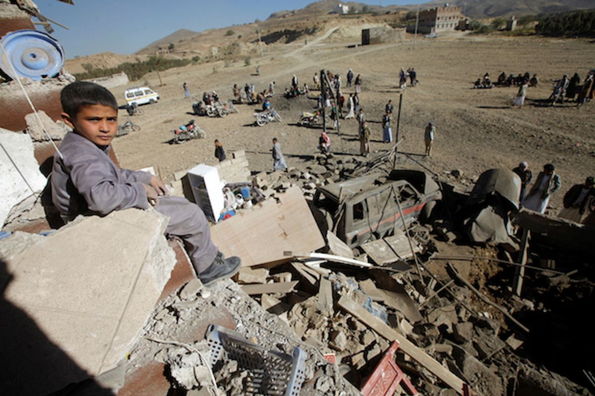 A Yemeni boy sits on the wreckage of a house destroyed by a U.S.-backed, Saudi-led airstrike on the outskirts of Sanaa, Yemen, November 13, 2016  (Reuters/Mohamed al-Sayaghi)