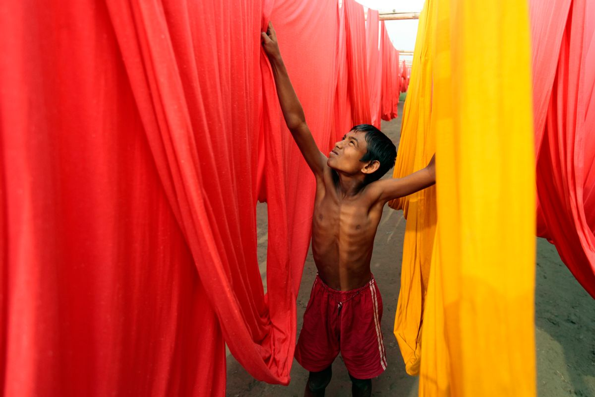 FILE- In this Saturday, Dec. 22, 2012 file photo, a Bangladeshi child works at a clothes-dyeing factory in Narayanganj, outskirts of Dhaka, Bangladesh. A new study by the London-based Overseas Development Institute found that thousands of Bangladeshi children who live in the capital's slums are working illegally for an average of 64 hours a week. (AP Photo/A.M. Ahad, File) (AP)