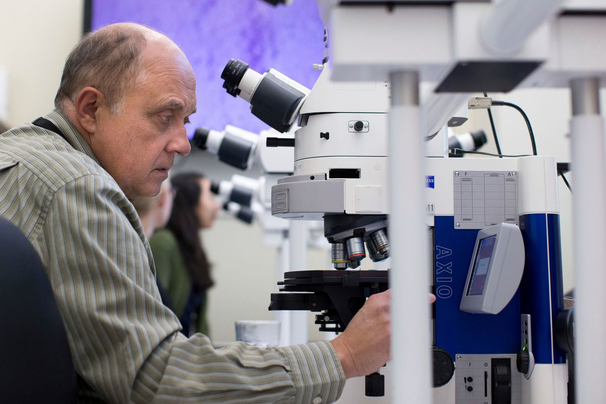 In this Thursday, Nov. 10, 2016 photo, Dr. Sherif Zaki adjusts a microscope at the Centers for Disease Control and Prevention in Atlanta. On Monday, Dec. 5, 2016, the nation's top public health agency issued a frank assessment of its recent battles against prioritized health problems, finding progress in some areas but backslide in others. Despite the mixed grades in the CDC's report card on itself, some experts applauded CDC efforts, saying the agency had only limited abilities to prevent illness or stop people from doing things that hurt their own health. (AP Photo/Branden Camp) (AP)