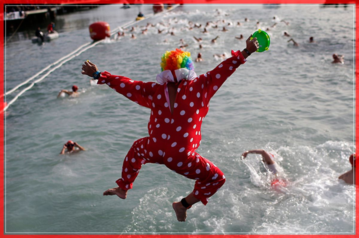 An athlete dressed as a clown jumps into the Mediterranean sea as he takes part in the Copa Nadal in the Spanish port of Barcelona in Barcelona, Spain, Sunday, Dec. 25, 2016. The Copa Nadal (Christmas Cup) is a traditional swimming competition that takes place in Barcelona every December 25th, where participants swim 200 meters in the open sea in the port of Barcelona. (AP Photo/Manu Fernandez) (AP)