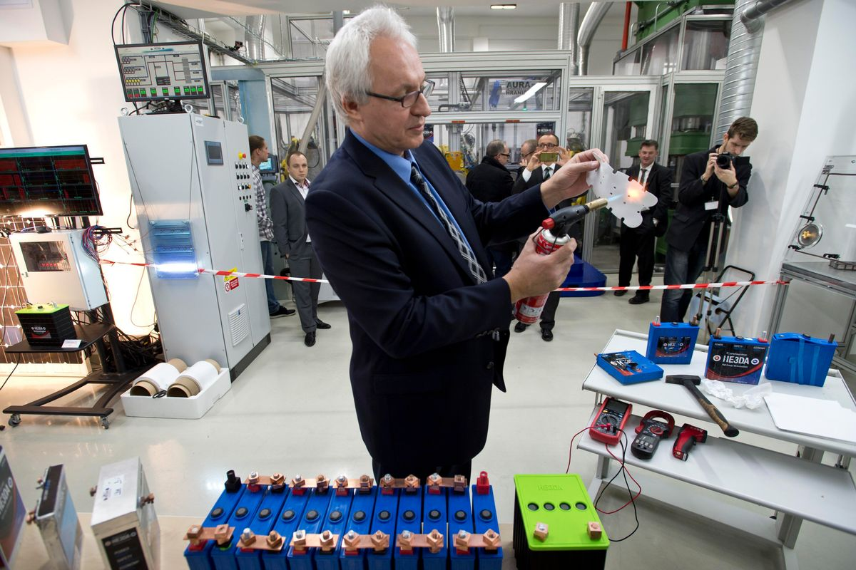 Company HE3DA President Jan Prochazka shows qualities of a new battery during the  official start of a battery production line in Prague, on Monday, Dec. 19, 2016. The new battery is based on nanotechnology and is supposed to be be more efficient, long-lasting, cheaper, lighter and above all safer. The battery is designed to store energy from renewable electric sources and cooperate with smart grids. Next planned type will be suitable for electric cars. (Michal Kamaryt /CTK via AP) (AP)