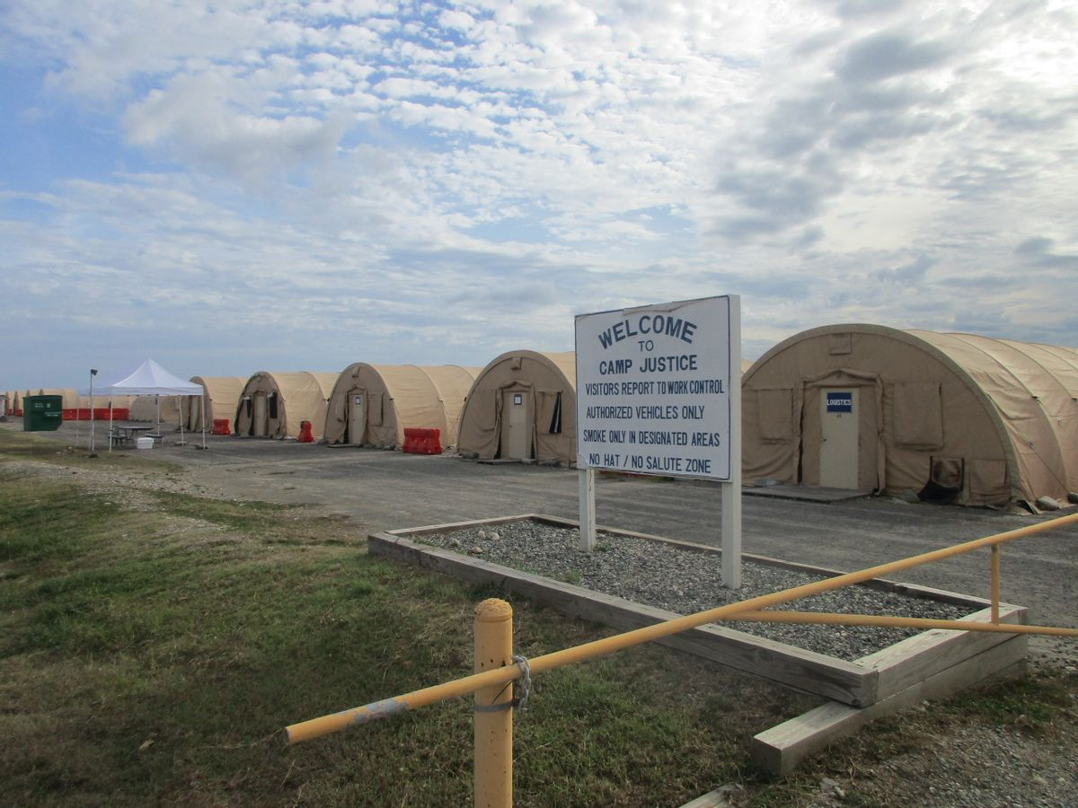 This Dec. 10, 2016 photo, shows the exterior of Camp 6 at the detention center at the U.S. Navy base at Guantanamo Bay, Cuba, where the U.S. holds 59 prisoners, including 22 cleared for release. The military has consolidated all remaining prisoners in Camp 6 and Camp 7, leaving other parts of the detention center vacant. (A) (AP Photo/Ben Fox)