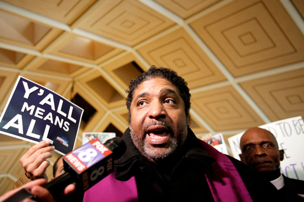 Civil rights leader Reverend William Barber, president of the NAACP in North Carolina, speaks to the media inside the state's Legislative Building (Reuters/Jonathan Drake)
