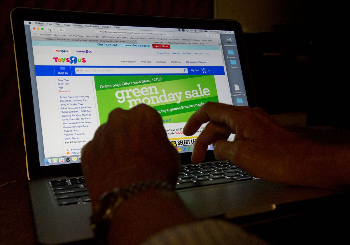 """An online shopper searches different sites, Monday, Dec. 12, 2016, from Miami. Unfortunately, there's no time like the holidays for fraud. Online shopping is convenient and popular, for shoppers and scammers alike. Experts suggest restricting your purchases to reputable vendors, and be wary of lookalike websites, where the name of a well-known brand is slightly off. Also, don't click on emails and links from unfamiliar senders, and make payments only on secure sites indicated by a lock symbol or """"https"""" in the web address. (AP Photo/Wilfredo Lee) (AP)"""