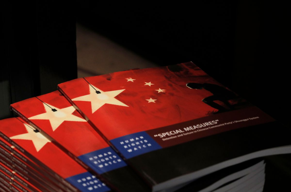 Copies of the new report by Human Rights Watch are seen at The Foreign Correspondents' Club in Hong Kong, Tuesday, Dec. 6, 2016. (AP)