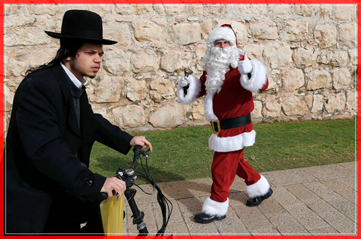 An Ultra-Orthodox Jew rides past a Palestinian man dressed up as Santa Claus outside Jaffa Gate in Jerusalem's Old City, on December 23, 2016, as Christians around the world prepare to celebrate the holy day. / AFP / AHMAD GHARABLI        (Photo credit should read AHMAD GHARABLI/AFP/Getty Images) (Afp/getty Images)