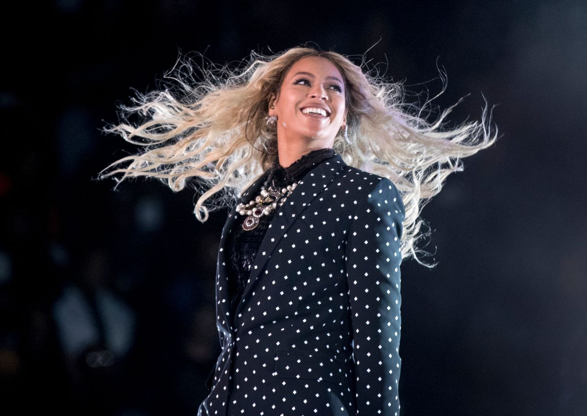 """FILE - In this Nov. 4, 2016 file photo, Beyonce performs at a Get Out the Vote concert for Democratic presidential candidate Hillary Clinton in Cleveland. The pop star is the leader of the 2017 Grammys with nine nominations, including bids for album of the year with """"Lemonade,"""" and song and record of the year with """"Formation,"""" announced Tuesday, Dec. 6. The singer, who already has 20 Grammys, is also the first artist to earn nominations in the pop, rock, R&B and rap categories in the same year. () (AP Photo/Andrew Harnik, File)"""