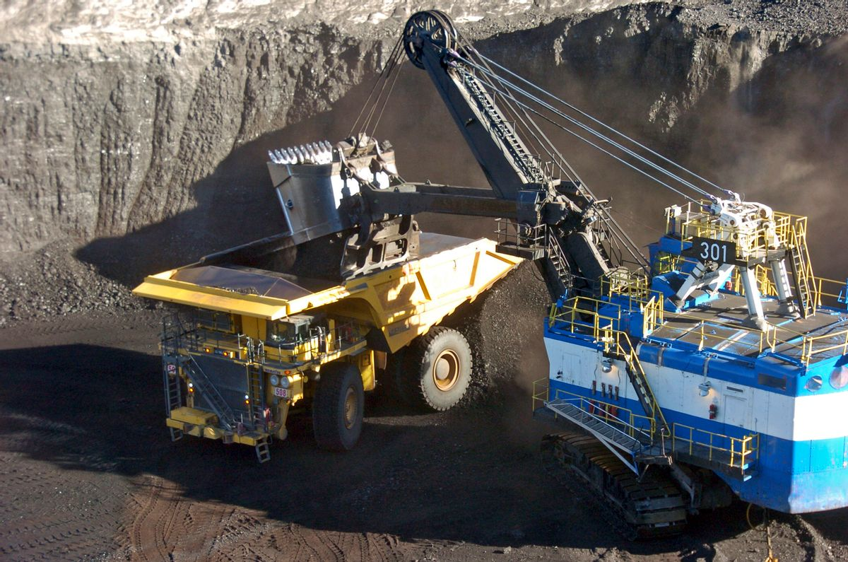 FILE - In this Nov. 15, 2016 file photo, a mechanized shovel loads coal from an 80-feet thick seam into a haul truck at Cloud Peak Energy's Spring Creek mine near Decker, Mont.  (AP Photo/Matthew Brown, File) (AP)