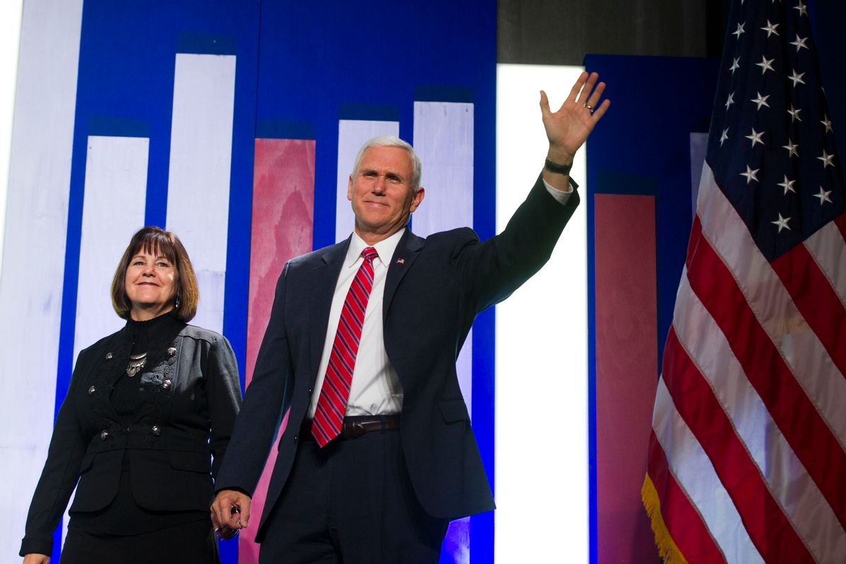 Vice President-elect Mike Pence and his wife Karen walks onstage at the Heritage Foundation's 2016 President's Club Meeting in Washington, Tuesday, Dec. 6, 2016. (AP)