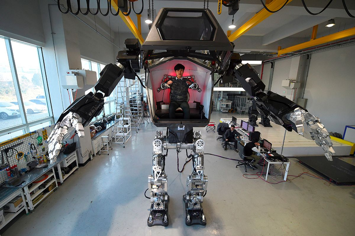 """TOPSHOT - Engineers test a four-metre-tall humanoid manned robot dubbed Method-2 in a lab of the Hankook Mirae Technology in Gunpo, south of Seoul, on December 27, 2016. The giant human-like robot bears a striking resemblance to the military robots starring in the movie """"Avatar"""" and is claimed as a world first by its creators from a South Korean robotic company. (Jung Yeon-Je/AFP/Getty Images))"""