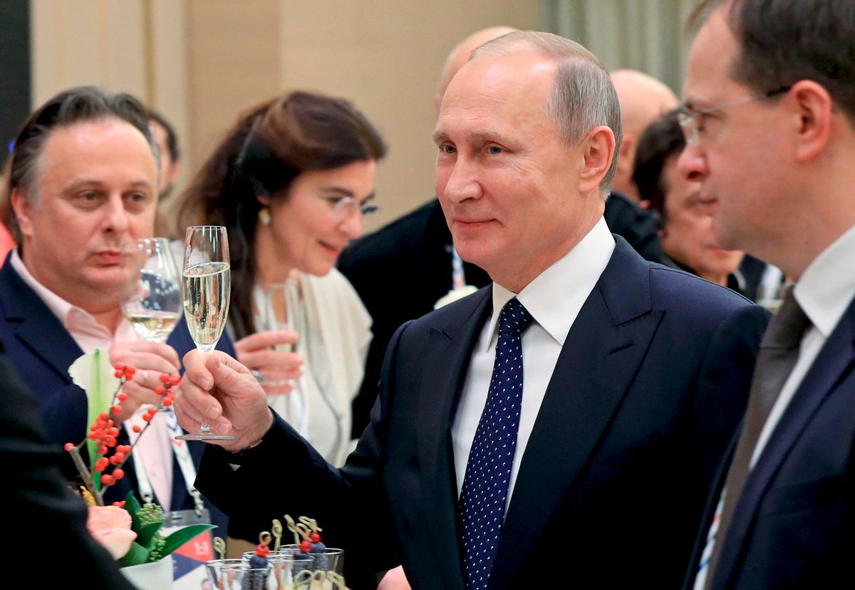 In this photo taken Friday, Dec. 2, 2016 Russian President Vladimir Putin toasts at a meeting with Russian and foreign cultural figures in the Mariinsky Theater in St. Petersburg, Russia. At right, Russian Culture Minister Vladimir Medinsky. At left back, Russia's Vakhtangov theater director Kirill Krok. (Mikhail Klimentyev/Sputnik, Kremlin Pool Photo via AP) (AP)