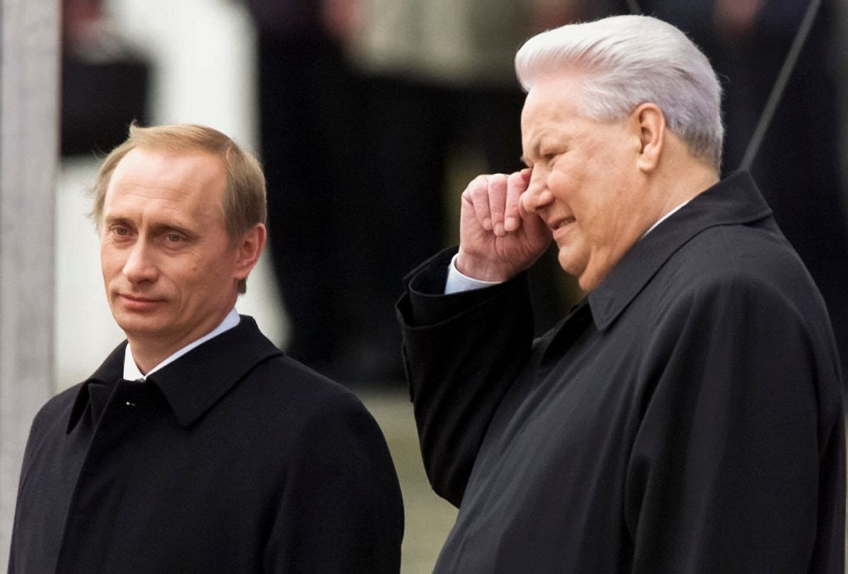 FILE In this file photo taken on Sunday, May 7, 2000, Russian President Vladimir Putin, left, and former President Boris Yeltsin watch Kremlin guards marching in Moscow's Kremlin, Russia. When Alexander Zemlianichenko started working as an AP photographer in Moscow, the Soviet Union was nearing its demise. (AP Photo/Alexander Zenlianichenko, file) (AP Photo/Alexander Zenlianichenko, file)