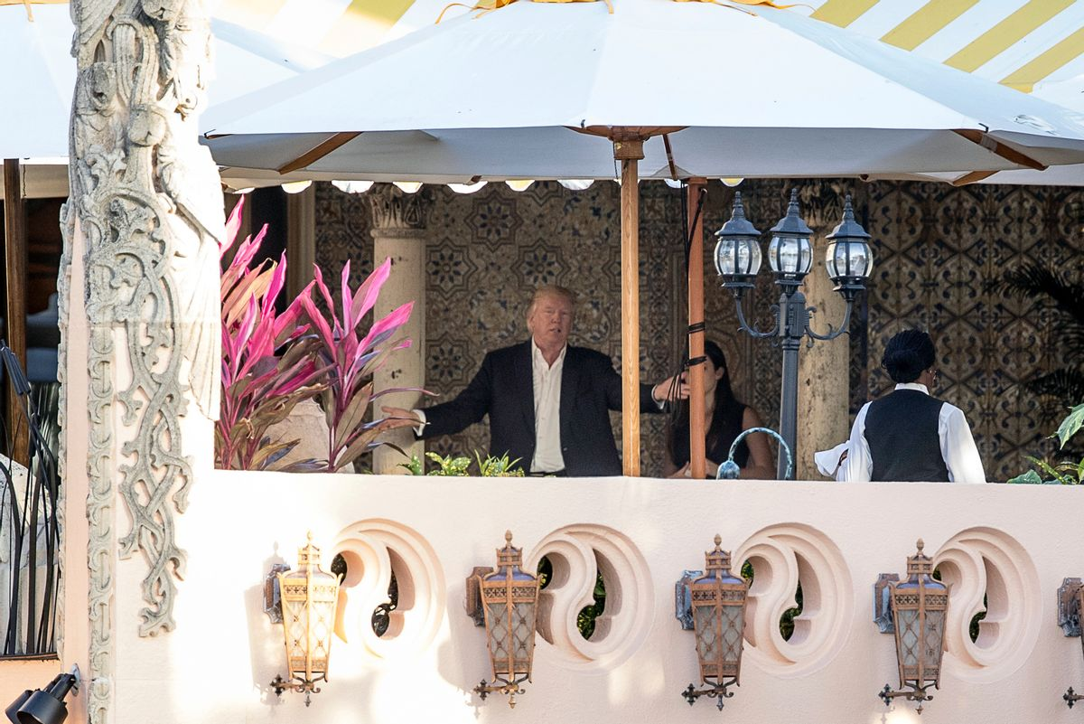 President-elect Donald Trump, center, speaks to an aide at Mar-a-Lago resort, in Palm Beach, Fla., Monday, Dec. 19, 2016.  (AP)