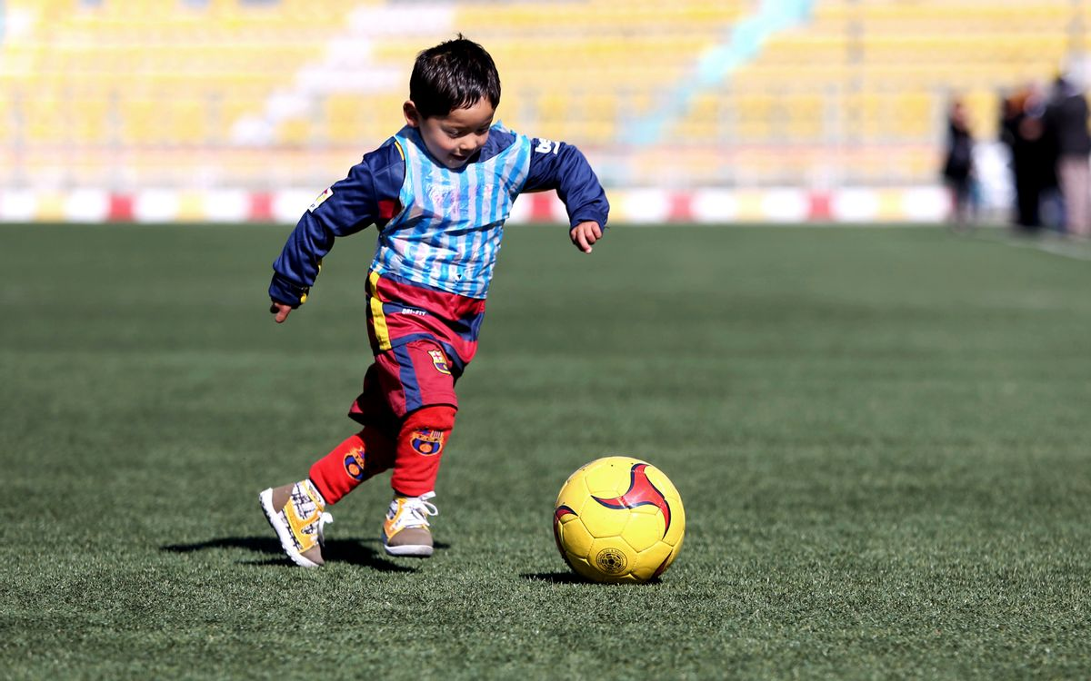FILE - In this Feb. 2, 2016, file photo, Murtaza Ahmadi, a five-year-old Afghan Lionel Messi fan plays soccer, at the Afghan Football Federation Stadium in Kabul, Afghanistan. The Afghan Football Federation set up a meeting between Messi and Ahmadi who became an Internet sensation when photos circulated of him wearing an improvised Messi shirt made from a plastic bag. (AP Photo/Rahmat Gul, File) (AP Photo/Rahmat Gul, File)
