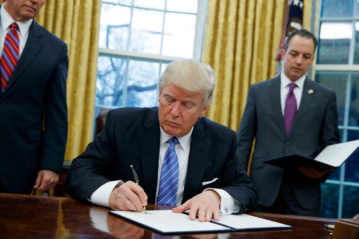FILE - In this Jan. 23, 2017, file photo, President Donald Trump signs an executive order to withdraw the U.S. from the 12-nation Trans-Pacific Partnership trade pact agreed to under the Obama administration in the Oval Office of the White House in Washington. (AP Photo/Evan Vucci, File) (AP)