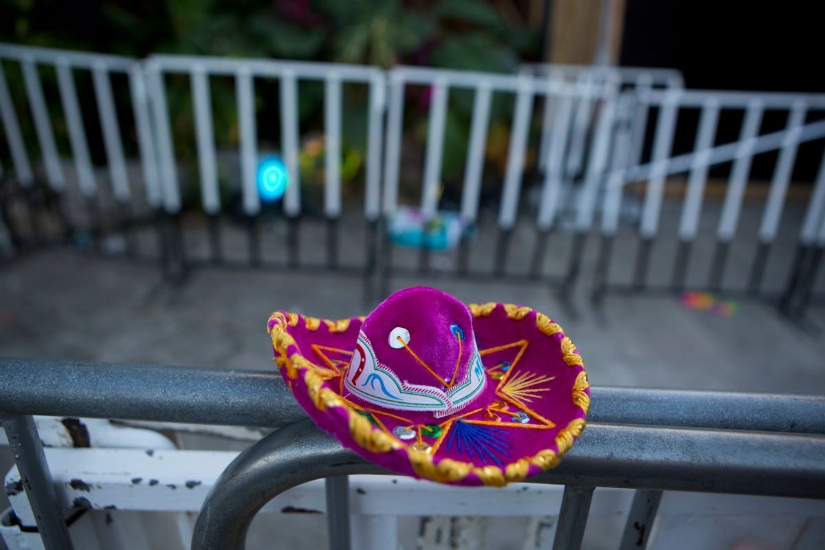 A Mexican tourist souvenir placed by a well-wisher sits on barriers blocking the entrance to the Blue Parrot club, where several people were killed in early morning gunfire, in Playa del Carmen, Mexico, Monday, Jan. 16, 2017. Deadly gunfire broke out in the crowded beachfront nightclub throbbing with electronic music before dawn on Monday, setting off a bloody stamped by screaming concertgoers at an international festival in this Caribbean resort.(AP Photo/Rebecca Blackwell) (AP)