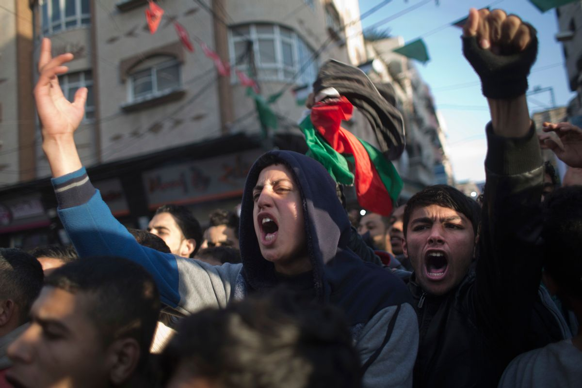 Palestinians chant slogans during a demonstration against the chronic power cuts in Jabaliya refugee camp, northern Gaza Strip, Thursday, Jan. 12, 2017. (AP Photo/ Khalil Hamra) (AP)