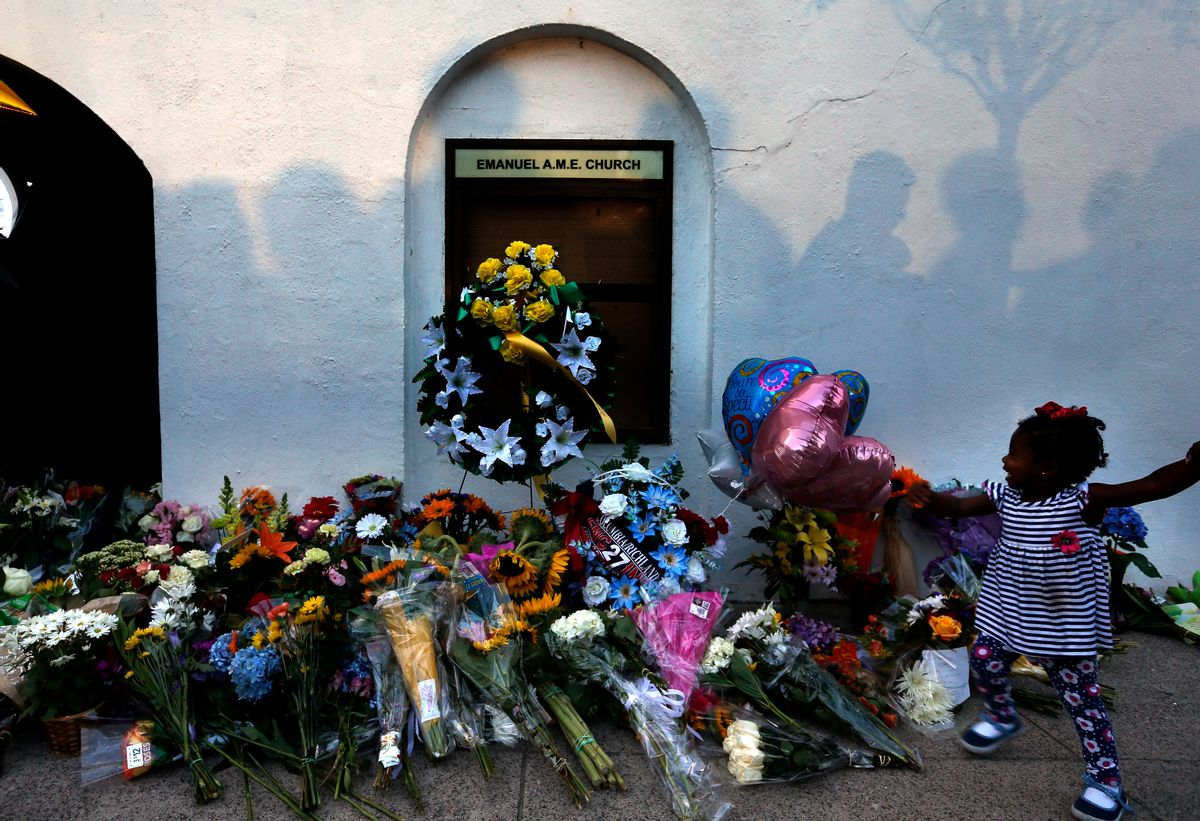 FILE-In this Thursday, June 18, 2015 file photo, mourners pass by a make-shift memorial on the sidewalk in front of the Emanuel AME Church following a shooting by Dylann Roof in Charleston, S.C. A federal jury will consider whether Roof should be sentenced to death or life in prison for killing nine black church members in a racially motivated attack. (AP Photo/Stephen B. Morton, File) (AP)