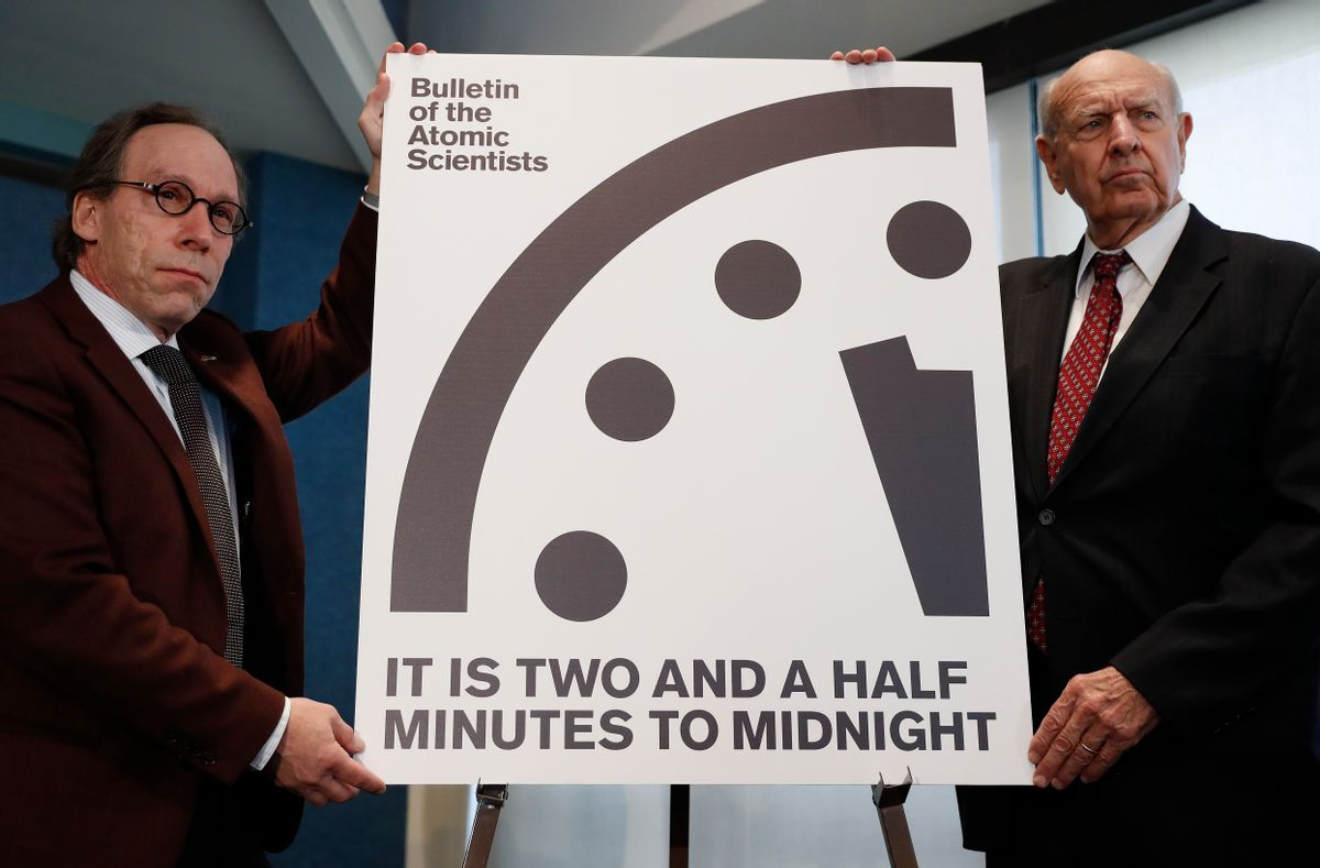 Lawrence Krauss, theoretical physicist, chair of the Bulletin of the Atomic ScientistsBoard of Sponsors, left, and Thomas Pickering, co-chair of the International Crisis Group, display the Doomsday Clock during a news conference the at the National Press Club in Washington, Thursday, Jan. 26, 2017, announcing that the Bulletin of the Atomic Scientist have moved the minute hand of the Doomsday Clock to two and a half minutes to midnight. (AP Photo/Carolyn Kaster) (AP)