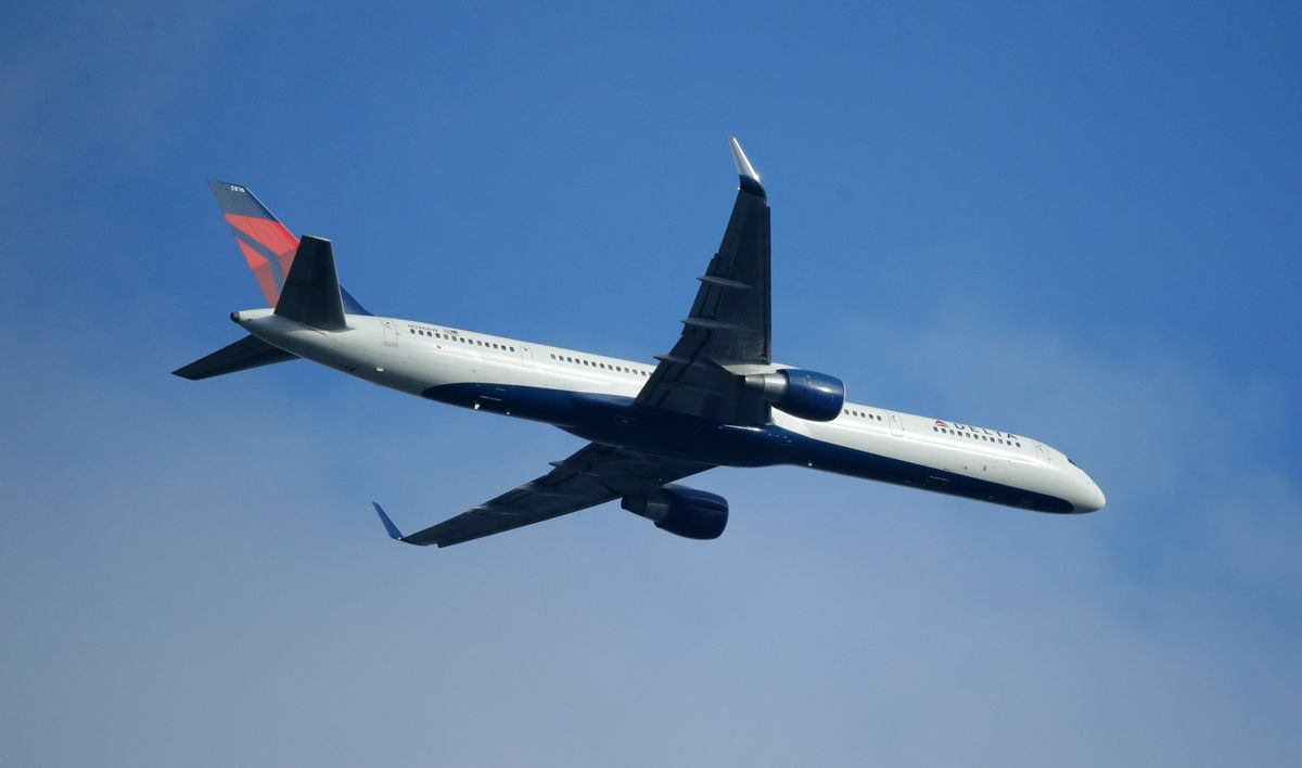 FILE - In this Sunday, March 6, 2016, file photo, a Delta Air Lines Boeing 757 flies overhead, in Seattle. On Thursday, Jan. 12, 2017, Delta Air Lines, Inc. reports financial results. (AP Photo/Ted S. Warren, File) (AP)