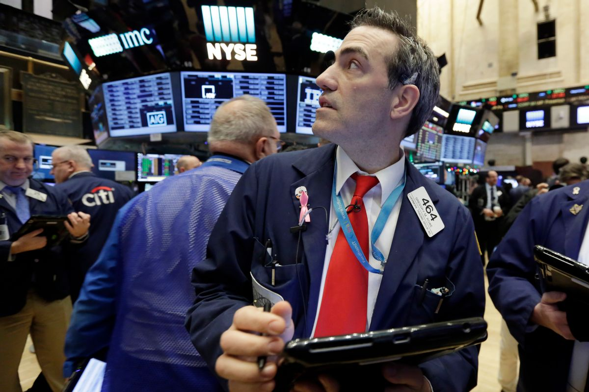 Trader Gregory Rowe works on the floor of the New York Stock Exchange, Tuesday, Jan. 3, 2017. The stock market opened the year on a strong note, led by big gains in banks and energy companies. (AP Photo/Richard Drew)) (AP)