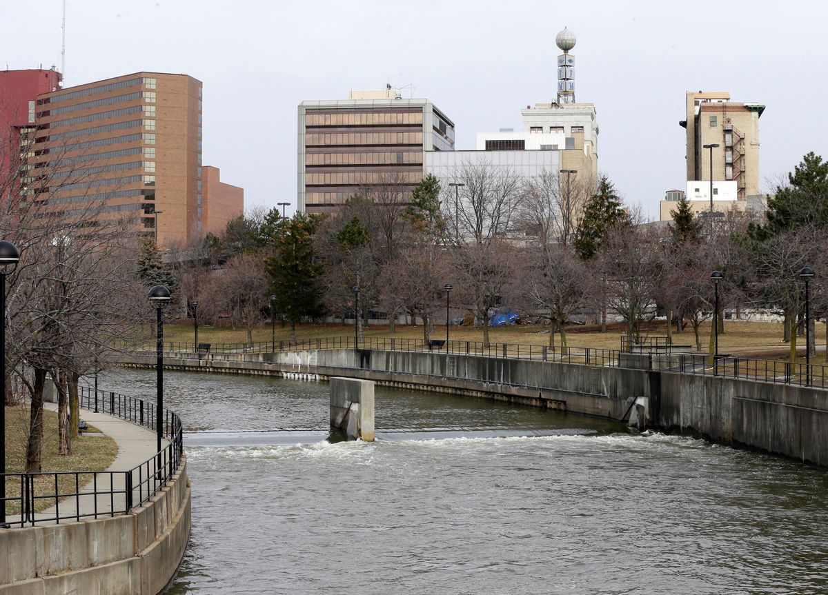 FILE - This Feb. 5, 2016, file photo, shows the Flint River in Flint, Mich. Michigan environmental officials announced Tuesday, Jan. 24, 2017, that Flint's water system no longer has levels of lead exceeding the federal limit. The finding by the Department of Environmental Quality is good news for a city whose 100,000 residents have grappled with the man-made water crisis since 2014. (AP Photo/Carlos Osorio, File) (AP)