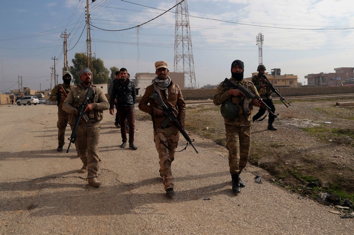 Iraqi security forces patrol in an area recently liberated from Islamic State in the predominantly Christian town of Tilkaif, Iraq, Saturday, Jan. 21, 2017. (AP Photo/Khalid Mohammed) (AP)