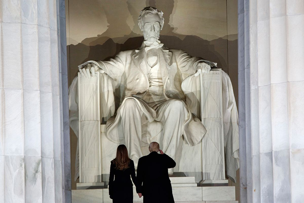 """President-elect Donald Trump, right, salutes as he arrives with his wife Melania Trump to the """"Make America Great Again Welcome Concert"""" at the Lincoln Memorial, Thursday, Jan. 19, 2017, in Washington. (AP Photo/Evan Vucci) (AP)"""