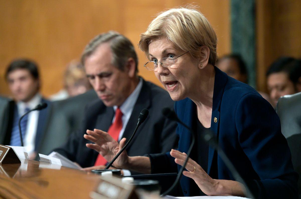 FILE - Sen. Elizabeth Warren, D-Mass., calls for halt to confirmation hearings until cabinet nominees pass standard ethics and background checks. (AP Photo/Susan Walsh, File) (AP)
