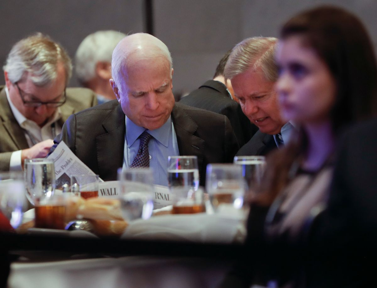 In this Jan. 26, 2017, photo, Sen. John McCain, R-Ariz., left, and Sen. Lindsey Graham, R-S.C., right, read the Wall Street Journal newspaper as they wait for President Donald Trump to speak at the House and Senate GOP lawmakers at the annual policy retreat in Philadelphia. McCain has emerged as Trump's top Republican nemesis on Capitol Hill. Since Trump's inauguration, McCain has broken with the president on his immigration order, warned him against any rapprochement with Moscow and lectured him on the illegality of torture. He supplied only a tepid endorsement of Rex Tillerson, Trump's secretary of state nominee. (AP Photo/Pablo Martinez Monsivais) (AP)