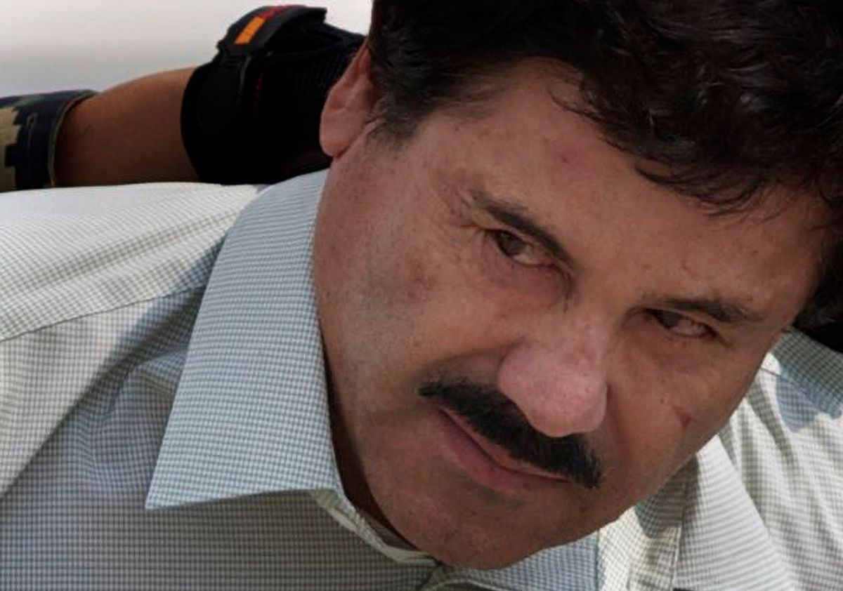 """FILE - In this Feb. 22, 2014 file photo, Joaquin """"El Chapo"""" Guzman is escorted to a helicopter in handcuffs by Mexican navy marines at a navy hanger in Mexico City. Mexico's government said on Thursday, Jan. 19, 2017, that it has extradited drug lord Joaquin """"El Chapo"""" Guzman to the U.S. to face drug trafficking and other charges. (AP Photo/Eduardo Verdugo, File) (AP)"""