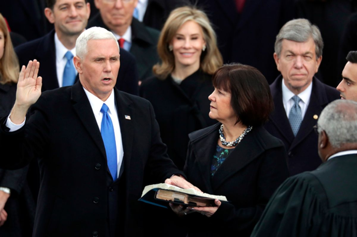 U.S. Vice President Mike Pence (L) takes the oath of office from Supreme Court Justice Clarence Thomas (R)    (Getty/Chip Somodevilla)