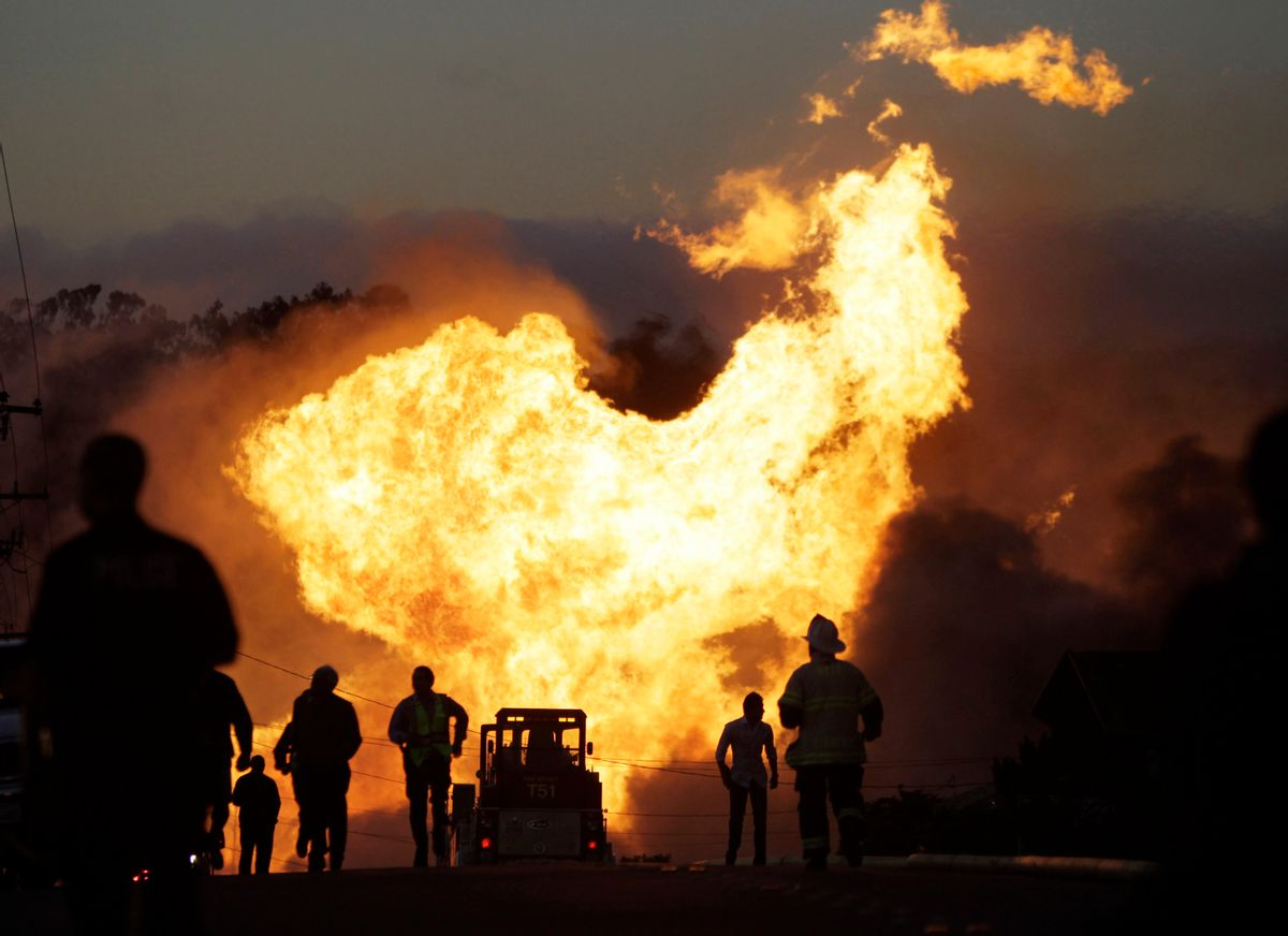 FILE - In this Sept. 9, 2010 file photo, a massive fire roars through a neighborhood in San Bruno, Calif. Pacific Gas & Electric Co. says it is prepared to pay the maximum fine of $3 million after a jury convicted the company of deliberately violating pipeline safety regulations before a deadly natural gas pipeline explosion in the San Francisco Bay Area and then misleading investigators looking into the blast. (AP Photo/Paul Sakuma, File) (AP)