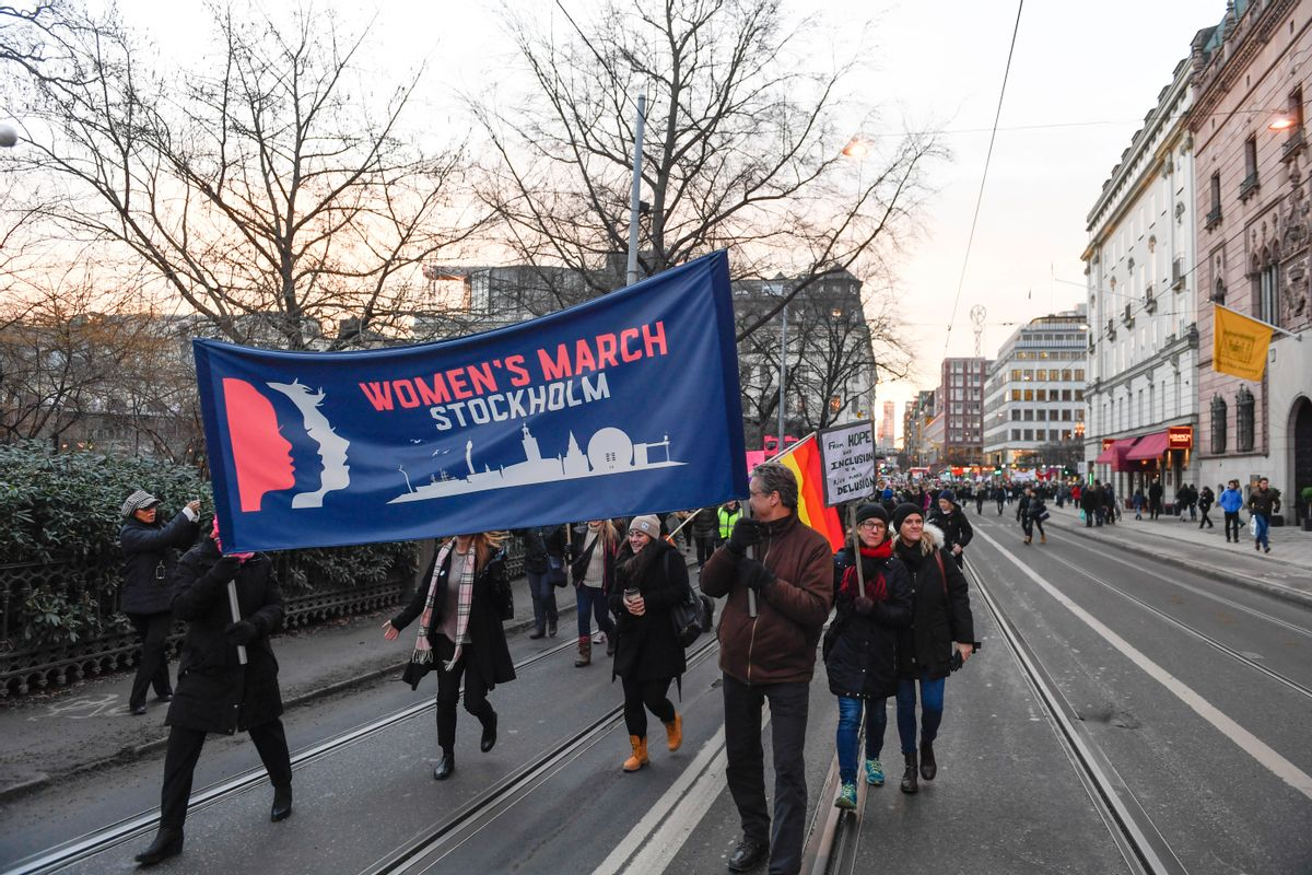 Protesters carrying banners and placards take part in a Women's March in Stockholm, Sweden, Saturday, Jan. 21, 2017. The march is part of a worldwide day of action following the inauguration of US president Donald Trump. () (Pontus Lundahl/TT News Agency via AP)