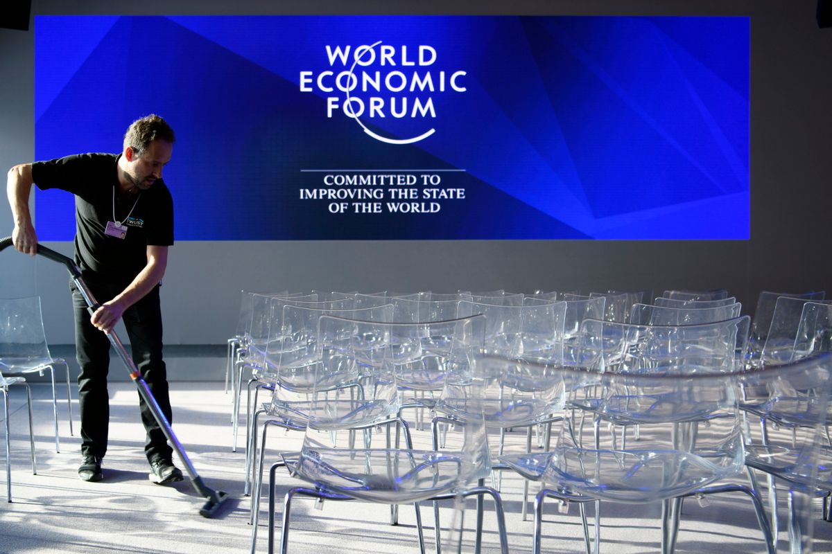 A worker vacuum-cleans the carpet inside the Congress Center ahead of the 47th annual meeting of the World Economic Forum, WEF, in Davos, Switzerland, Monday, Jan. 16, 2017. (Laurent Gillieron/Keystone via AP) (AP)