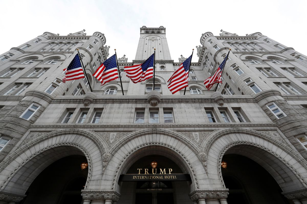 FILE - In this Dec. 21, 2106 file photo, the Trump International Hotel in Washington. An electrical subcontractor who worked on the Trump International Hotel in Washington has sued a company owned by President Donald Trump for more than $2 million, alleging it was not fully paid. (AP Photo/Alex Brandon, File) (AP)