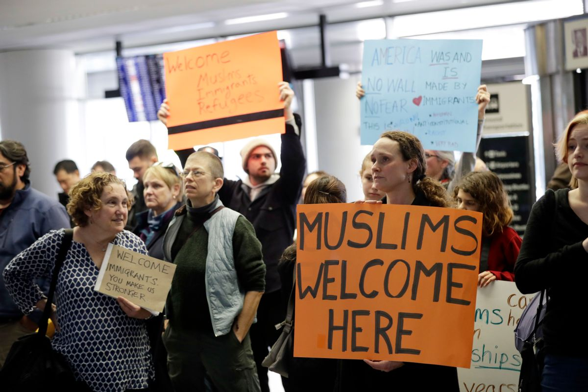 Protesters holds signs at San Francisco International Airport to denounce President Donald Trump's executive order that bars citizens of seven predominantly Muslim-majority countries from entering the U.S., Monday, Jan. 30, 2017, in San Francisco. () (AP Photo/Marcio Jose Sanchez)