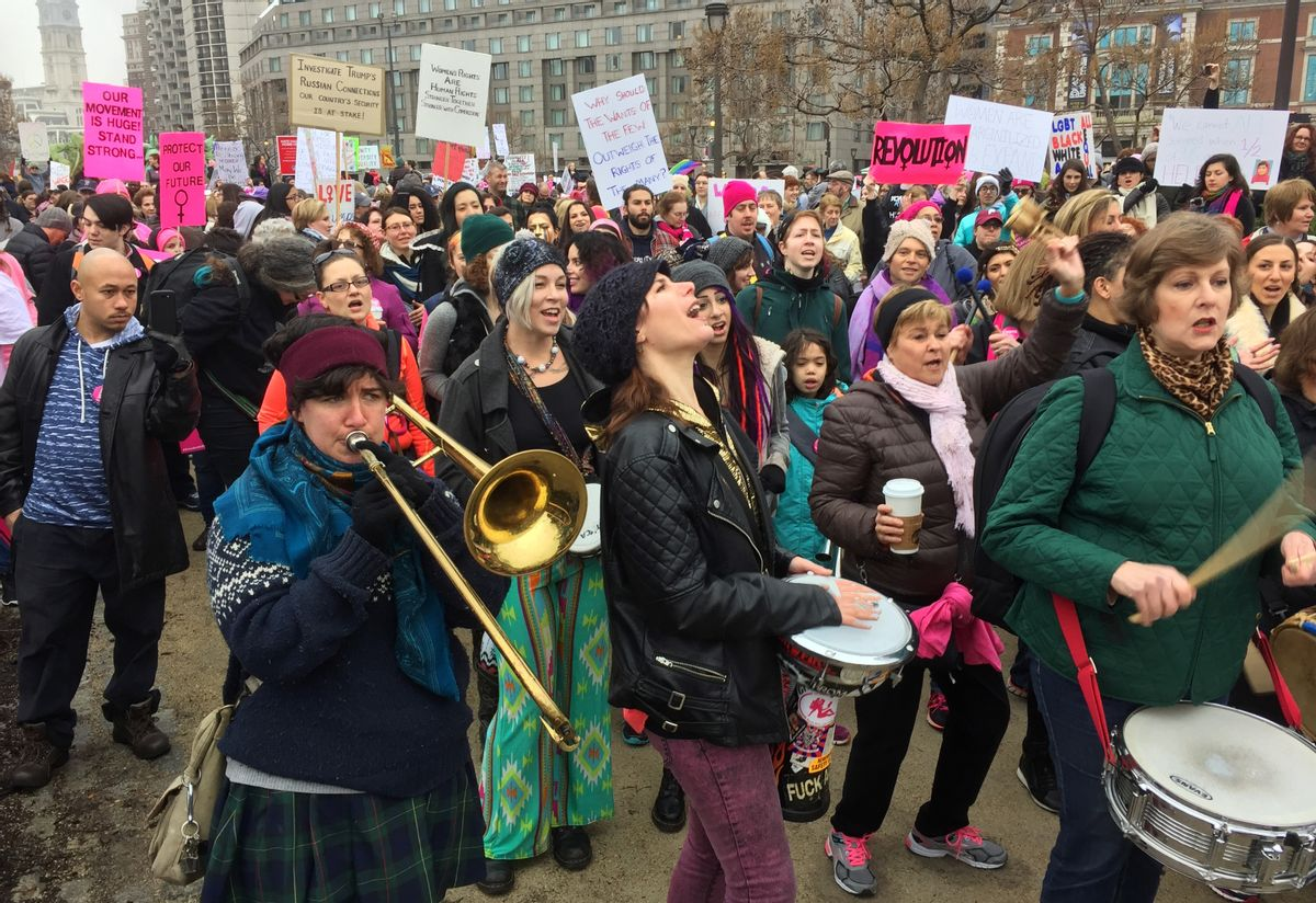 Protesters gather for the Women's March on Philadelphia a day after Republican Donald Trump's inauguration as president, Saturday, Jan. 21, 2017 in Philadelphia.  The march is being held in solidarity with similar events taking place in Washington and around the nation.  () (AP Photo/Jacqueline Larma)