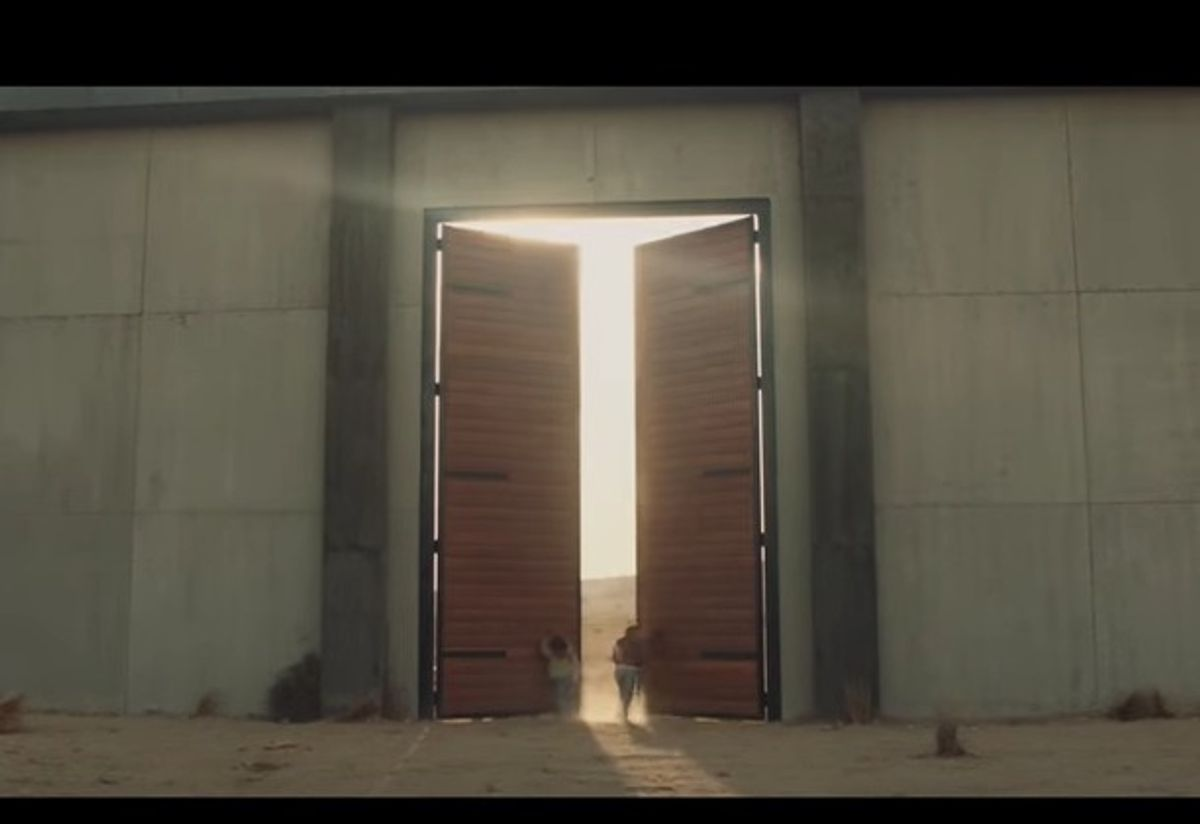A mother and daughter find a door in a border wall from Mexico in 84 Lumber's controversial Super Bowl 51 spot. (84 Lumber)