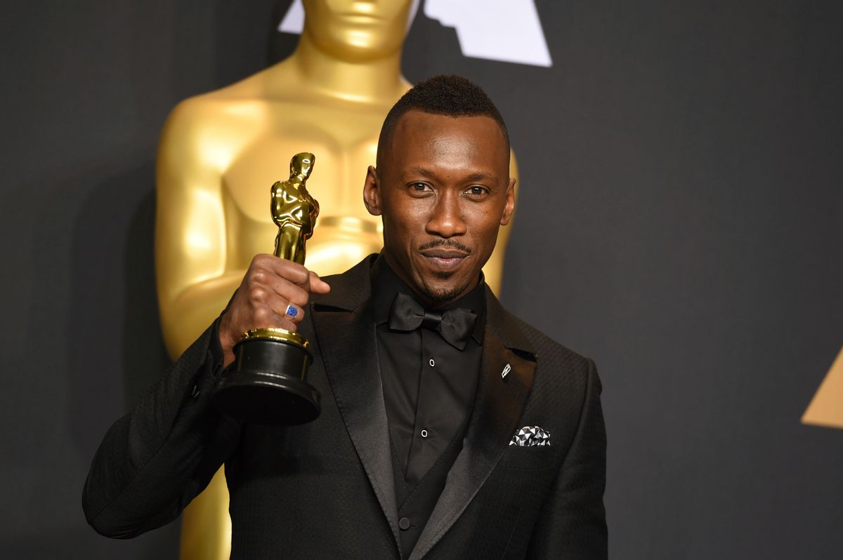 """Mahershala Ali poses in the press room with the award for best actor in a supporting role for """"Moonlight"""" at the Oscars on Sunday, Feb. 26, 2017, at the Dolby Theatre in Los Angeles. (Photo by Jordan Strauss/Invision/AP) (Jordan Strauss/invision/ap)"""