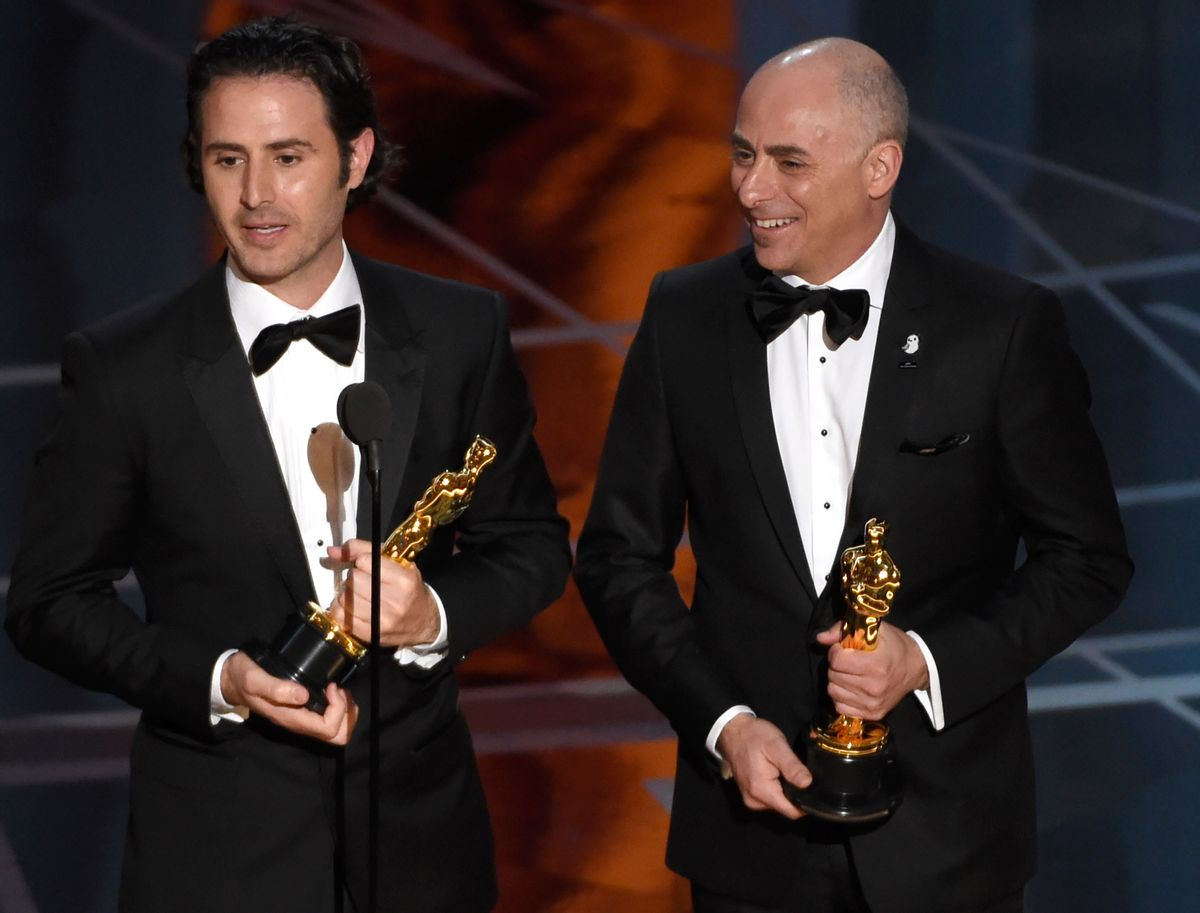 """Alan Barillaro, left, and Marc Sondheimer accept the award for best animated short film for """"Piper"""" at the Oscars on Sunday, Feb. 26, 2017, at the Dolby Theatre in Los Angeles. (Photo by Chris Pizzello/Invision/AP) (Chris Pizzello/invision/ap)"""