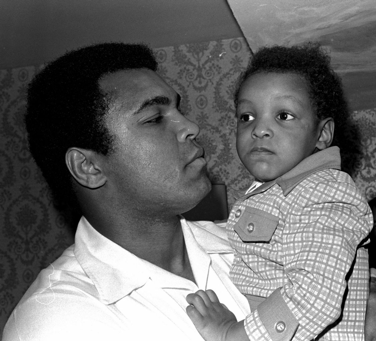 Heavyweight boxing champion Muhammad Ali, and Little Muhammad Ali, his 2 1/2 year old son, arrive at Miami Beach, Fla.   (Associated Press)