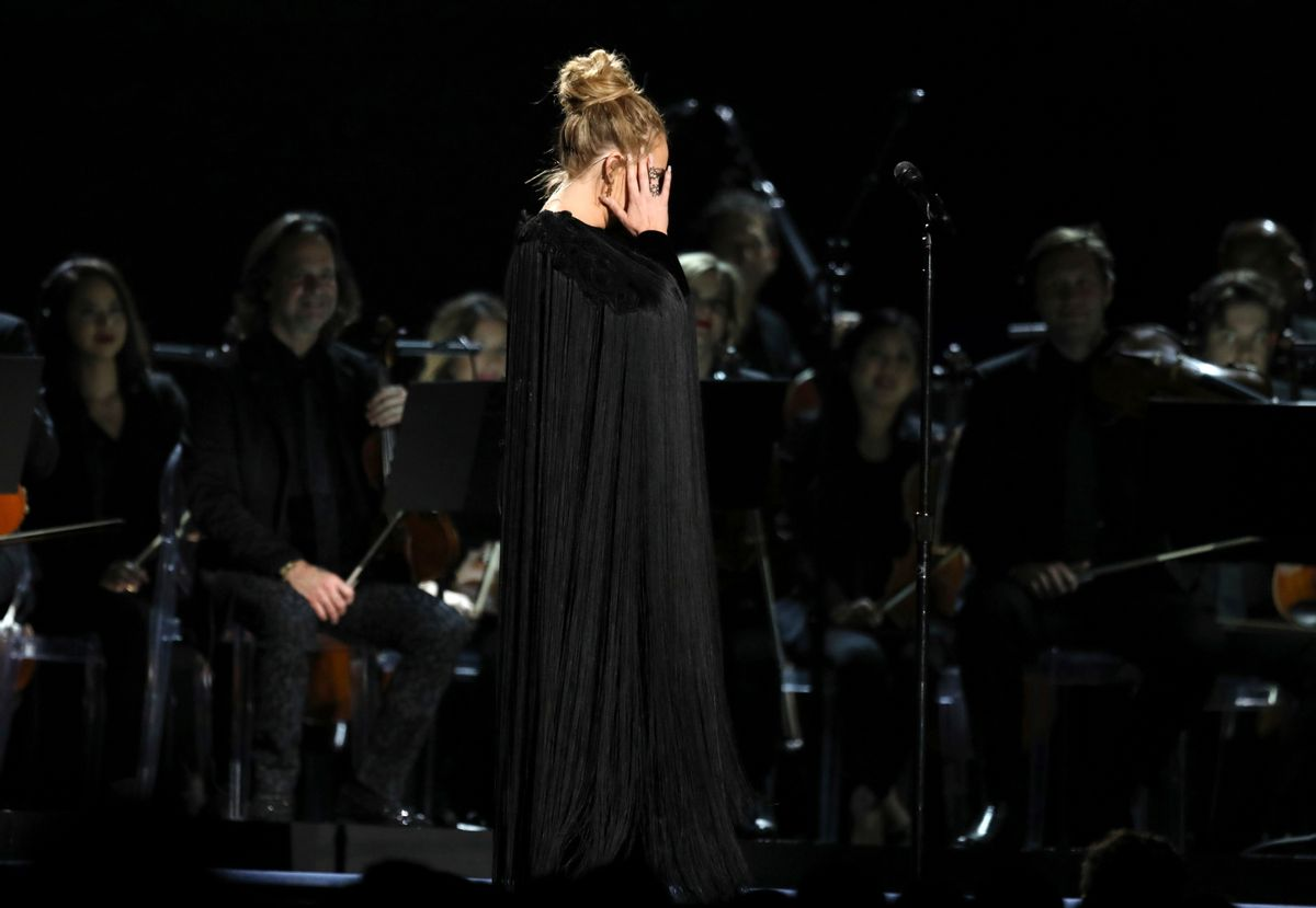 Adele reacts before restarting a performance tribute to George Michael at the 59th annual Grammy Awards on Sunday, Feb. 12, 2017, in Los Angeles. (Matt Sayles/invision/ap)
